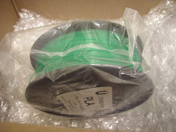 1.75mm reel of green PLA filament